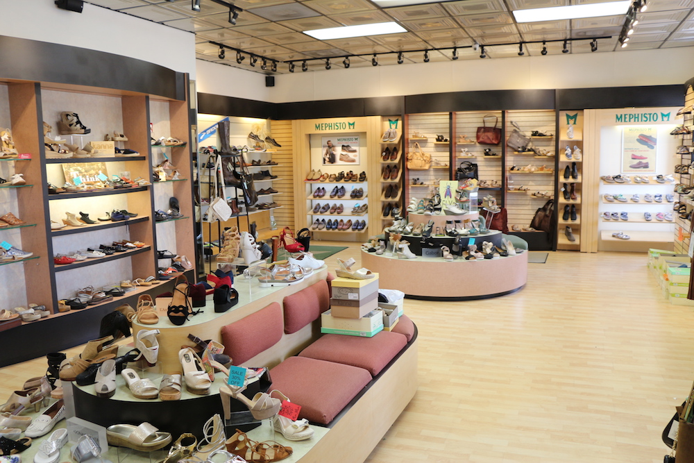 The inside of Sunset Shoes with a variety of women's shoes being displayed on wall mounted shelves.