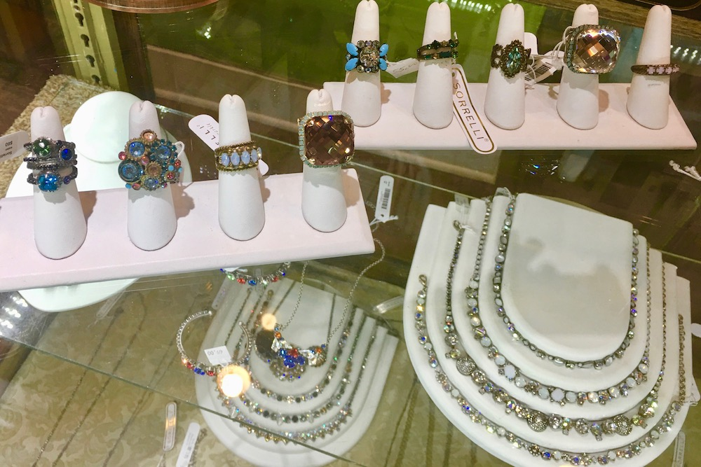 A glass display case with rings and necklaces in it at Favori Boutique in Sandestin, Florida.