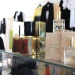 Two bottles of perfume on a glass case at Jewel Toffier Boutique,