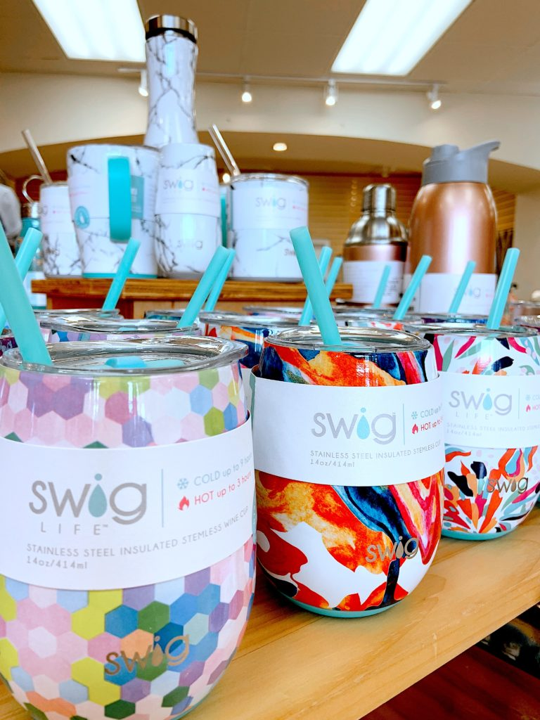 An assortment of multi-colored Swig stemless wine glasses at Sunset Shoes in Sandestin, Florida.