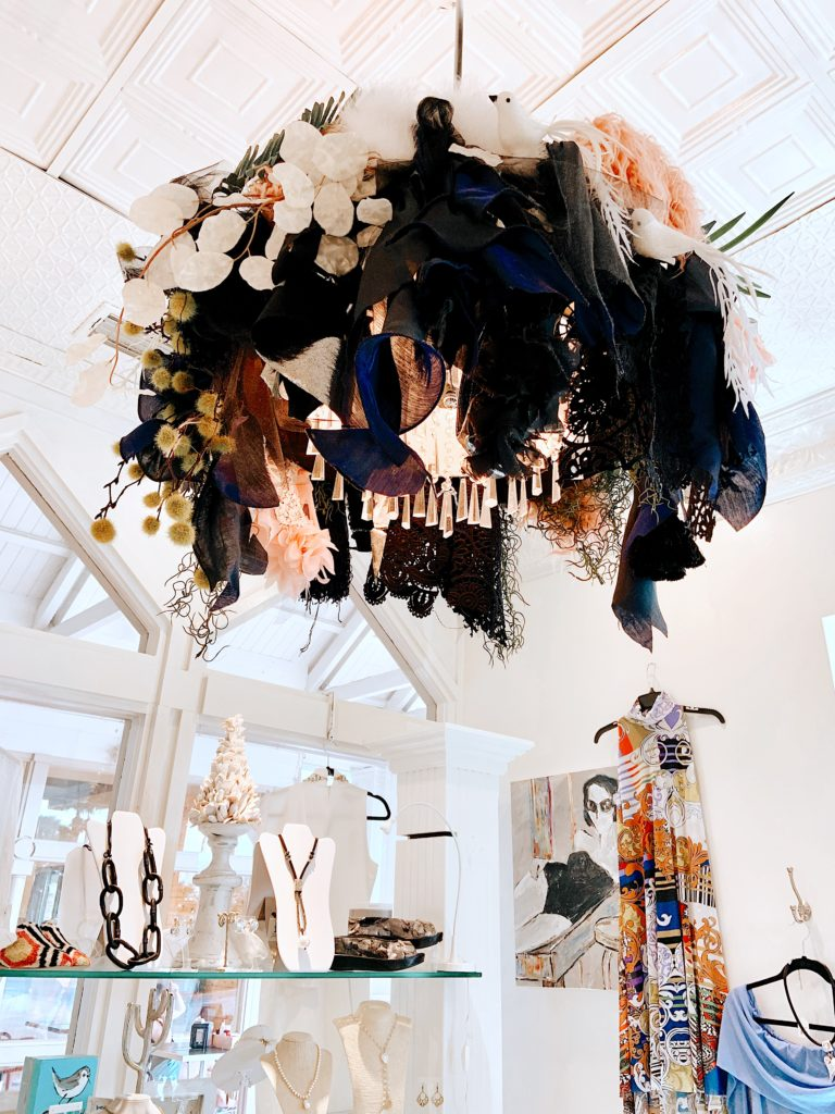 A chandelier inside of the Village Boutique made out of an assortment of different fabrics.